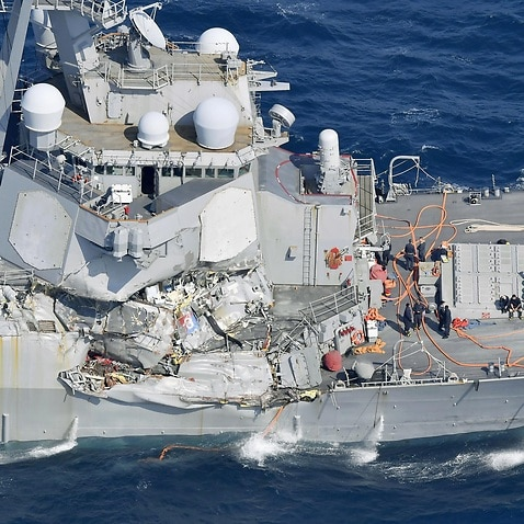 The damage of the right side of the USS Fitzgerald is seen off Shimoda, Shizuoka prefecture, Japan, after the Navy destroyer collided with a merchant ship