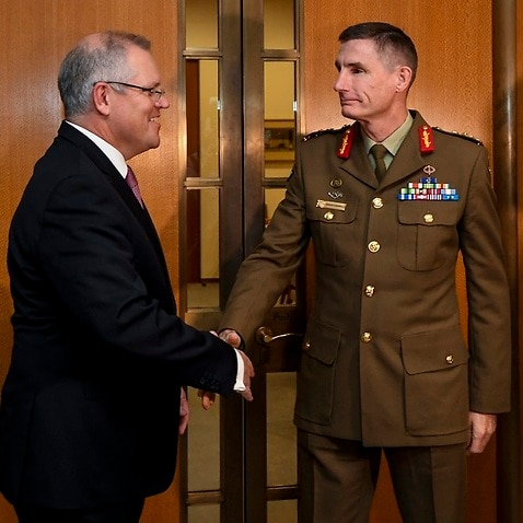 Chief of the Australian Defence Force General, Angus Campbell shakes hands with Australian Prime Minister Scott Morrison.
