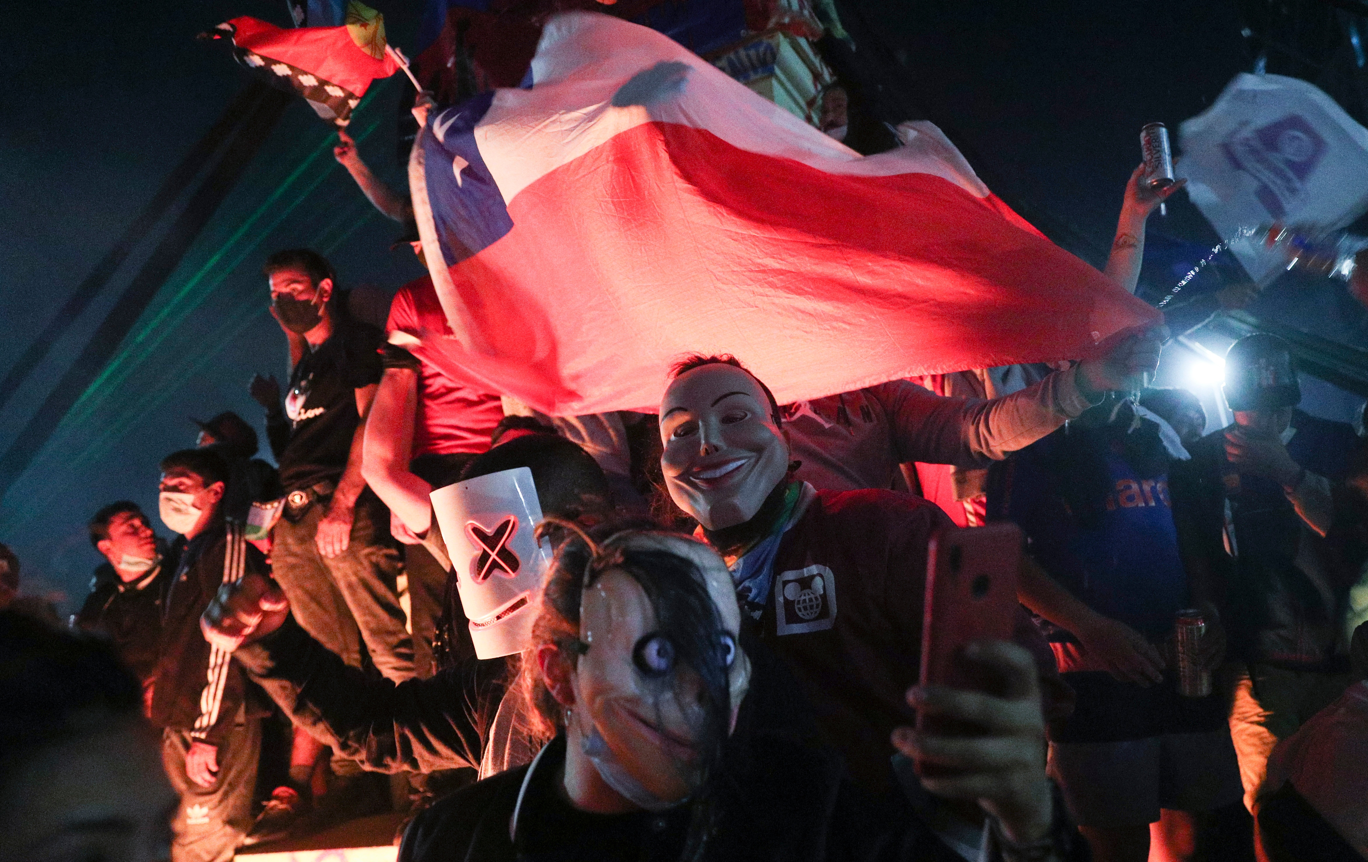 People gather at Plaza Italia on the day Chileans voted in a referendum to decide whether the country should replace its 40-year-old constitution