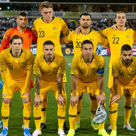 The Socceroos pose for a team photo before a match