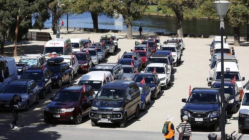 Cars in the 'Stop Adani Convoy' are seen lined up in Melbourne,