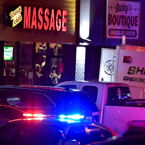 Authorities investigate a multiple fatal shooting at a massage parlour on Tuesday, 16 March in Woodstock, Georgia.