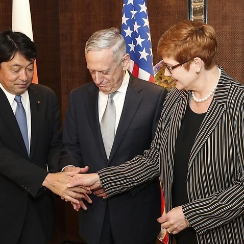 Japan's Itsunori Onodera, Jim Mattis and Marise Payne shake hands