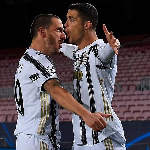 Cristiano Ronaldo celebrates a goal with Leonardo Bonucci