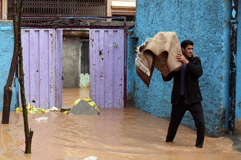 Flooding displaces tens of thousands in Iran. And more rain is forecast