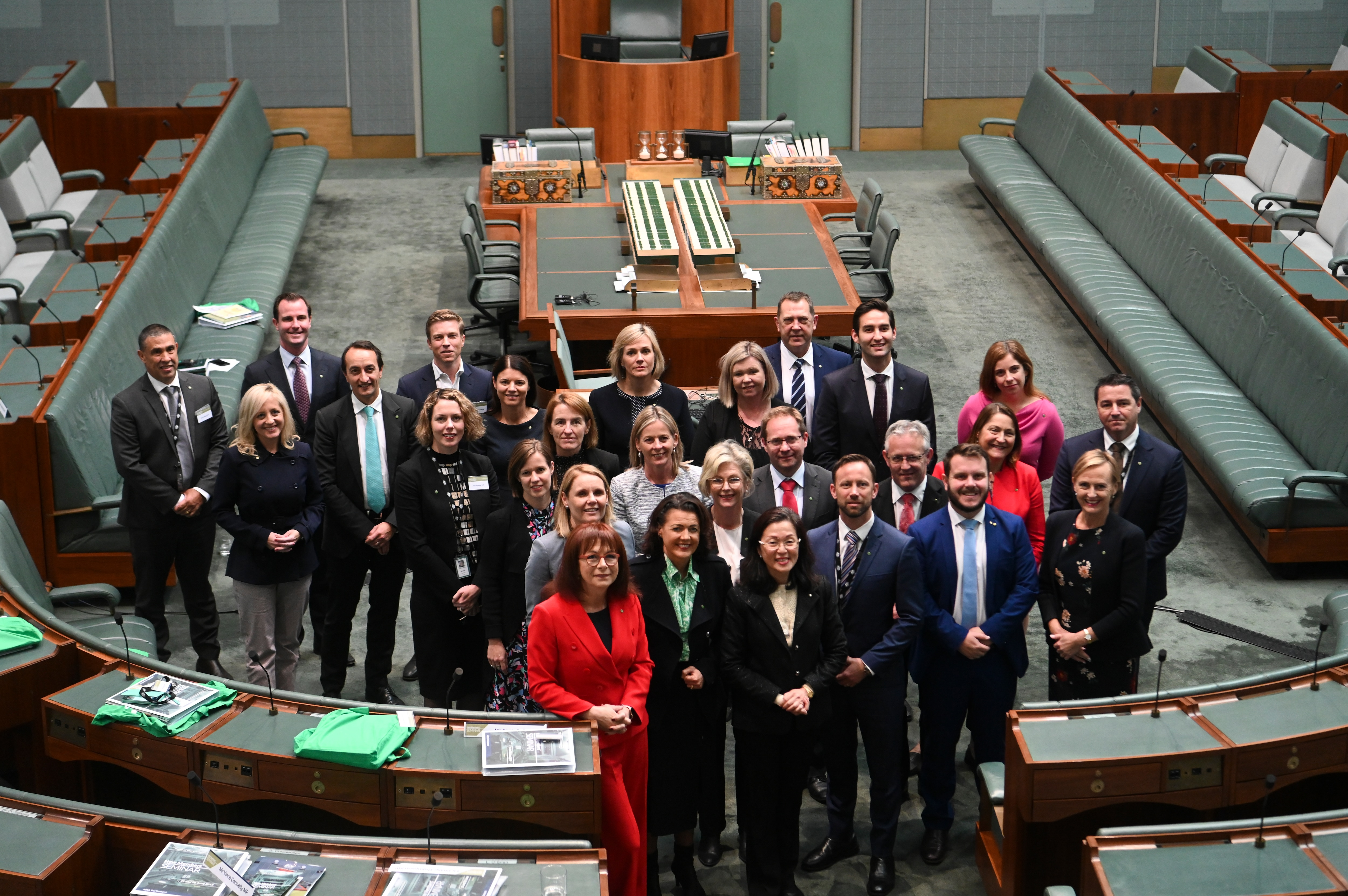 Newly elected MPs pose for photographs during a new Members' Seminar in the House of Representatives at Parliament House