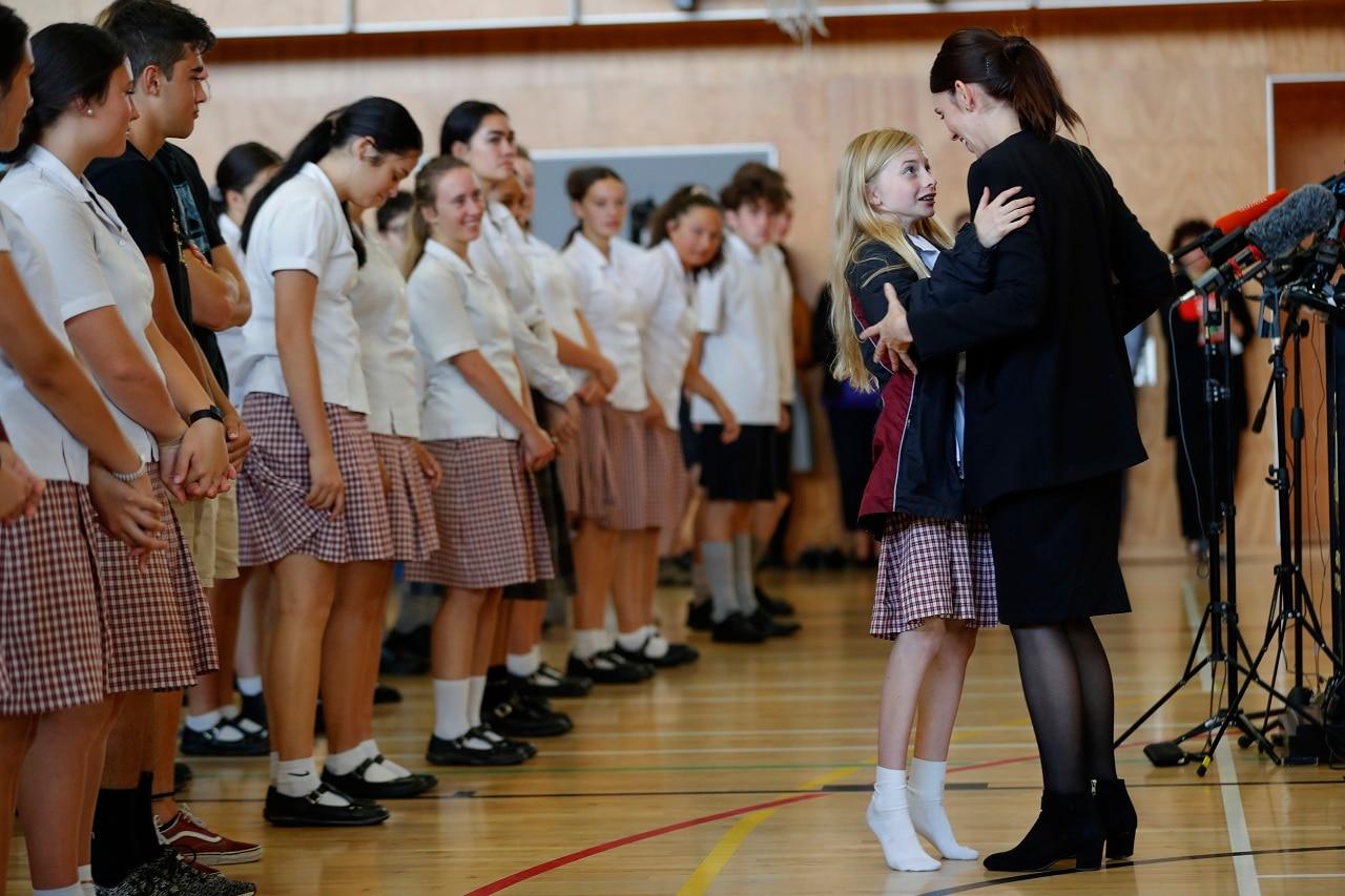 New Zealand's Prime Minister Jacinda Ardern hugs a student on Wednesday.