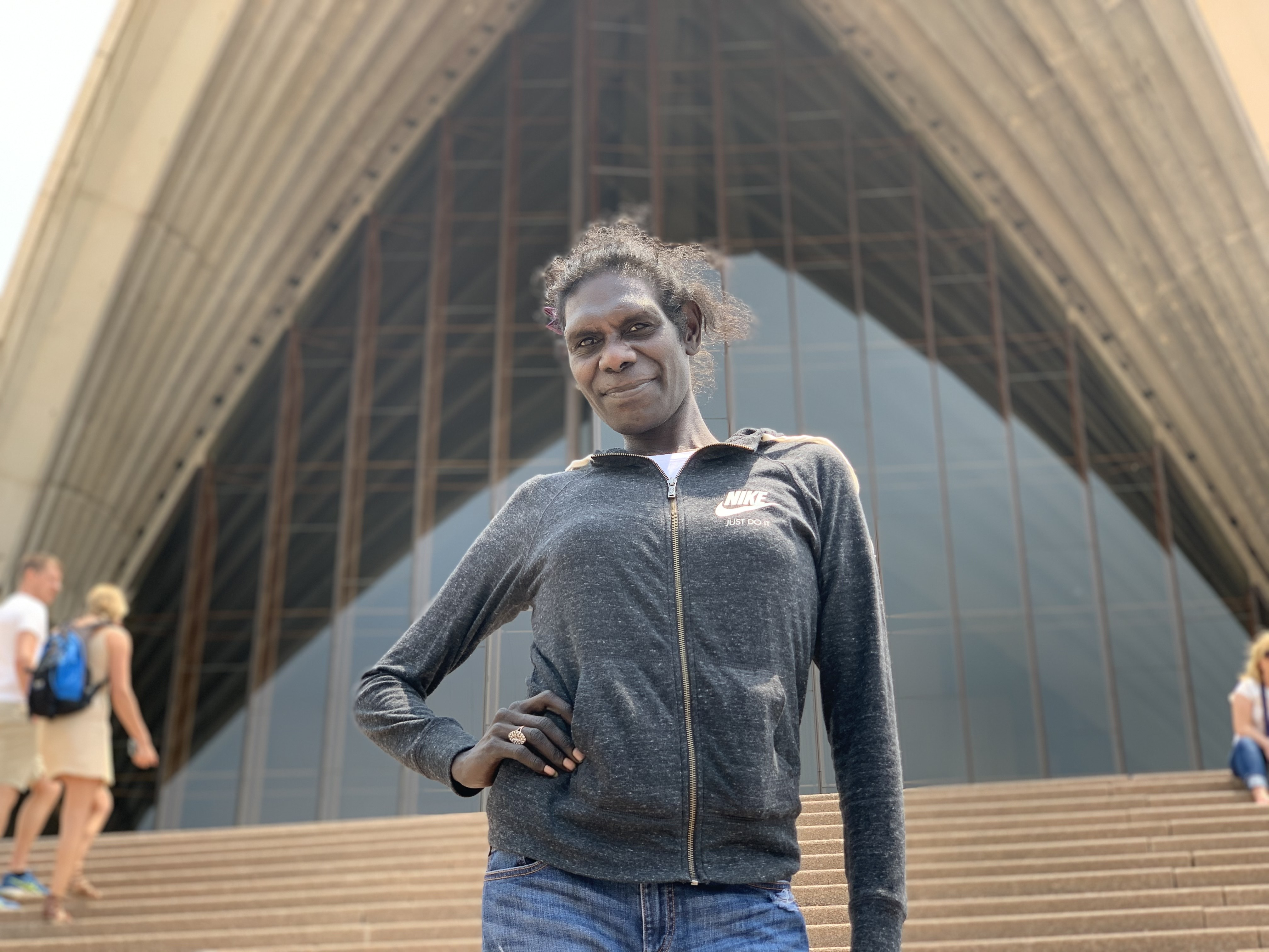 Laura Orsto strikes a pose in front of the Sydney Opera House.