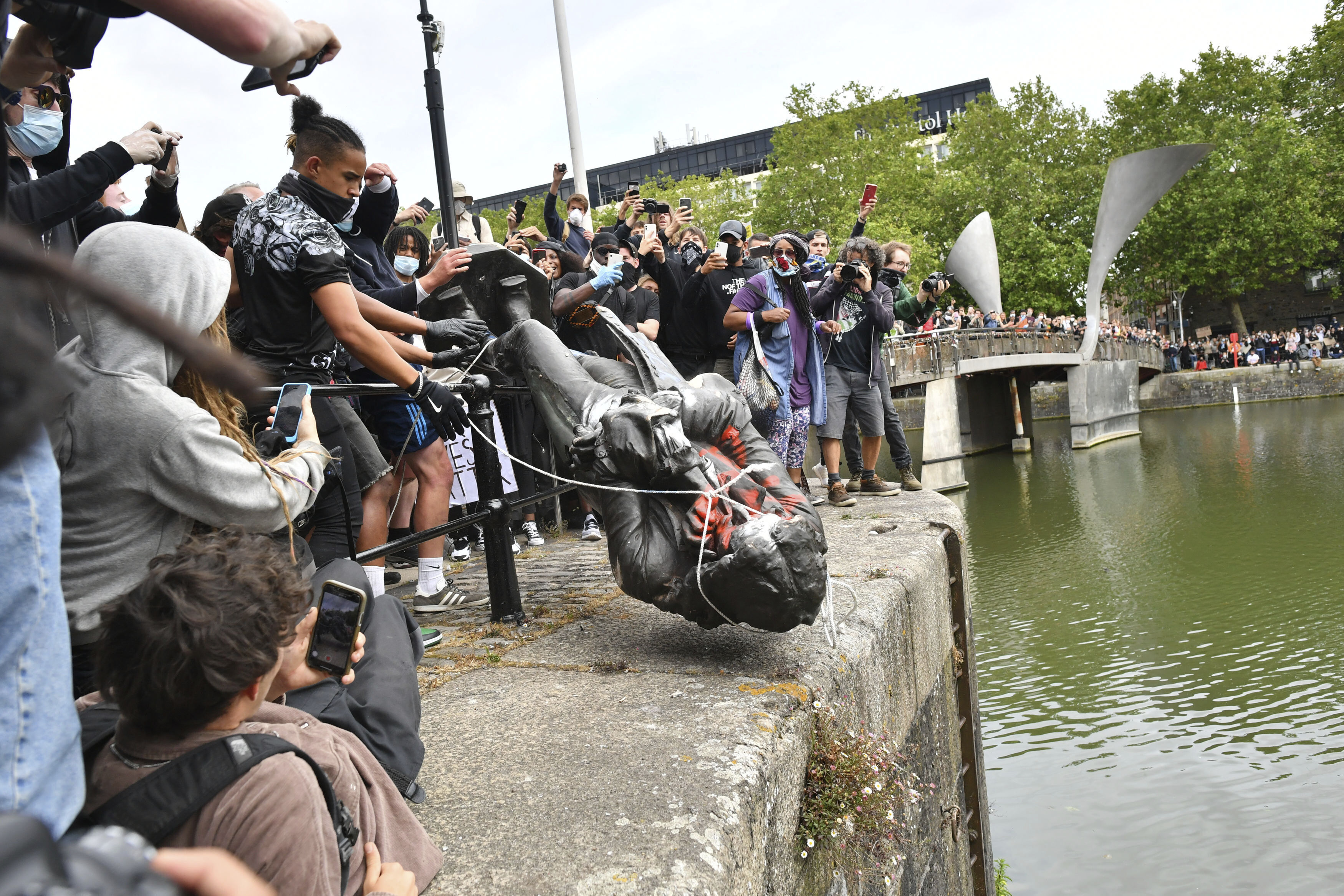 Protesters throw a statue of slave trader Edward Colston into Bristol harbour, during a Black Lives Matter protest rally, in Bristol, England.