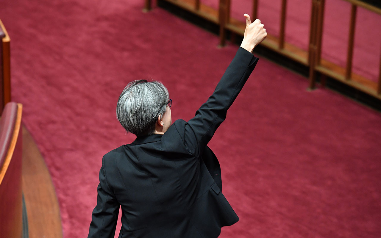 Shadow Minister for Foreign Affairs Penny Wong gives the thumbs up after the vote for the same-sex marriage bill in the Senate.