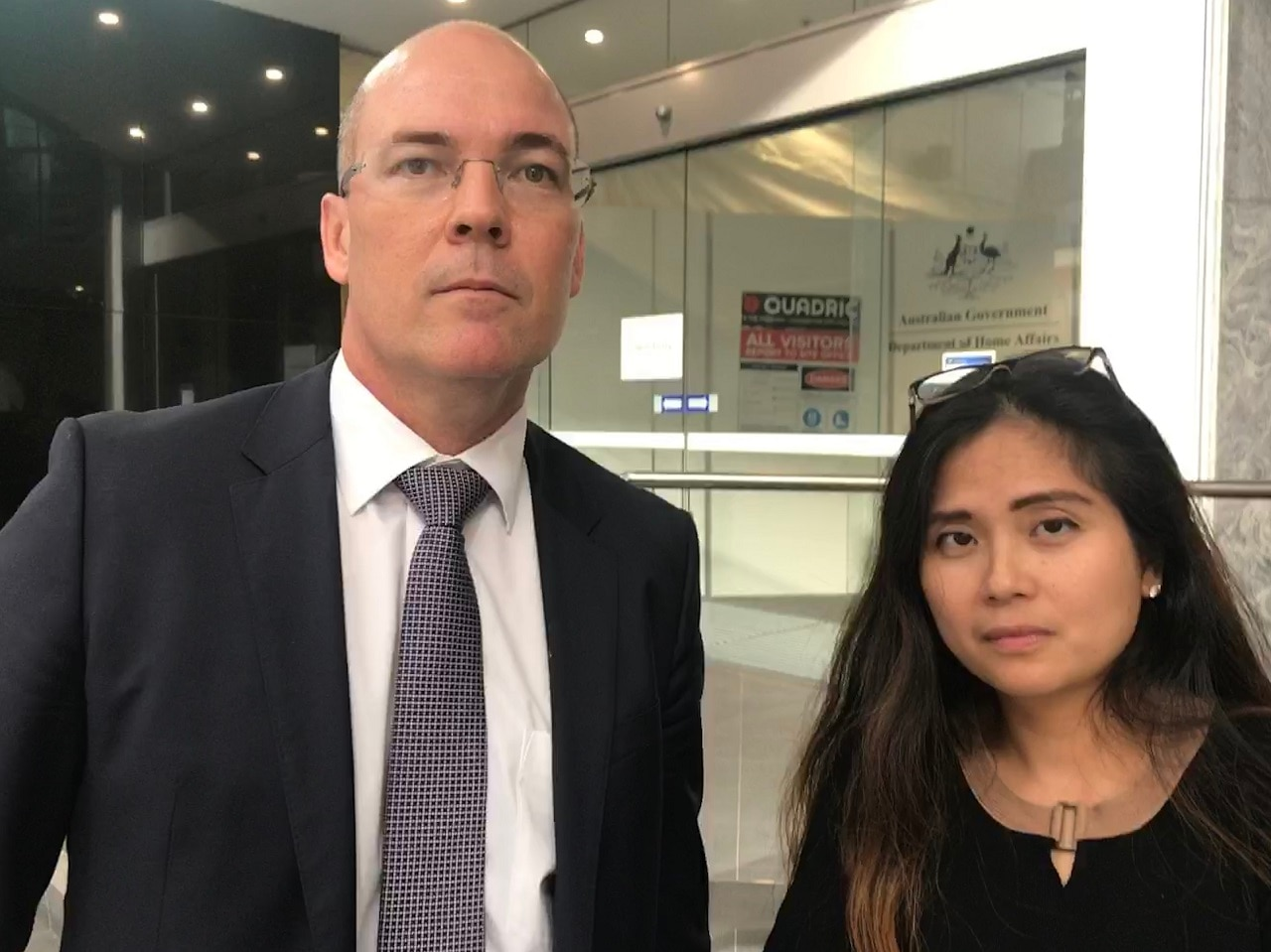 Bernadette Romulo (right) with her lawyer, Angus Francis.