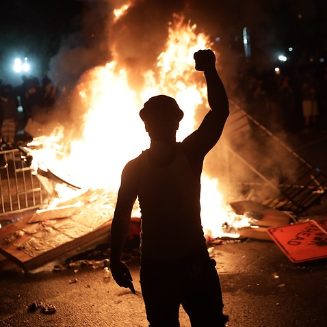 Demonstrators set a fire during a protest near the White House in Washington DC.