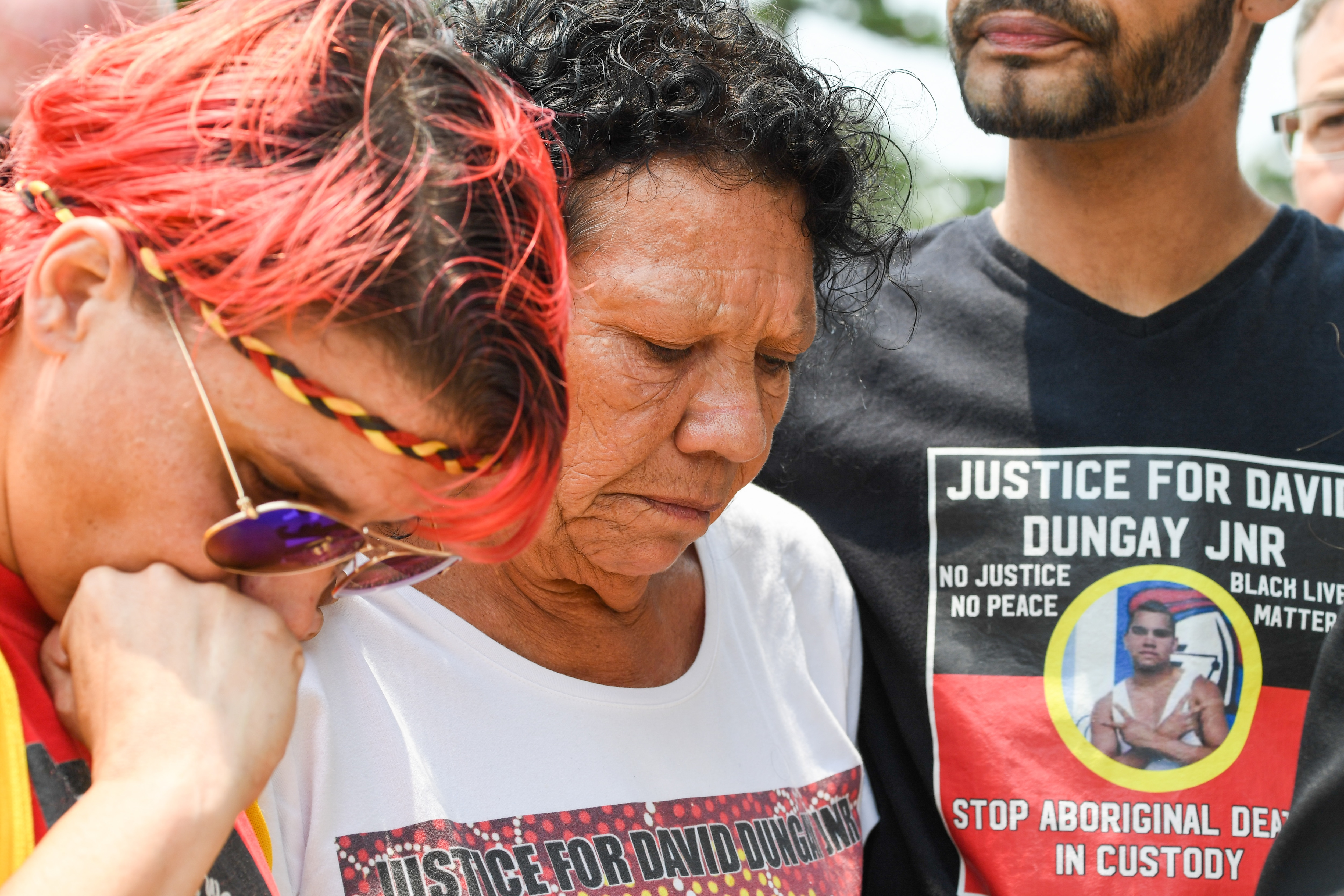 David Dungay's cousin Lizzie Jarrett and his mother Leetona Dungay and nephew Paul Silva outside the Lidcombe Coroner's Court in Sydney.