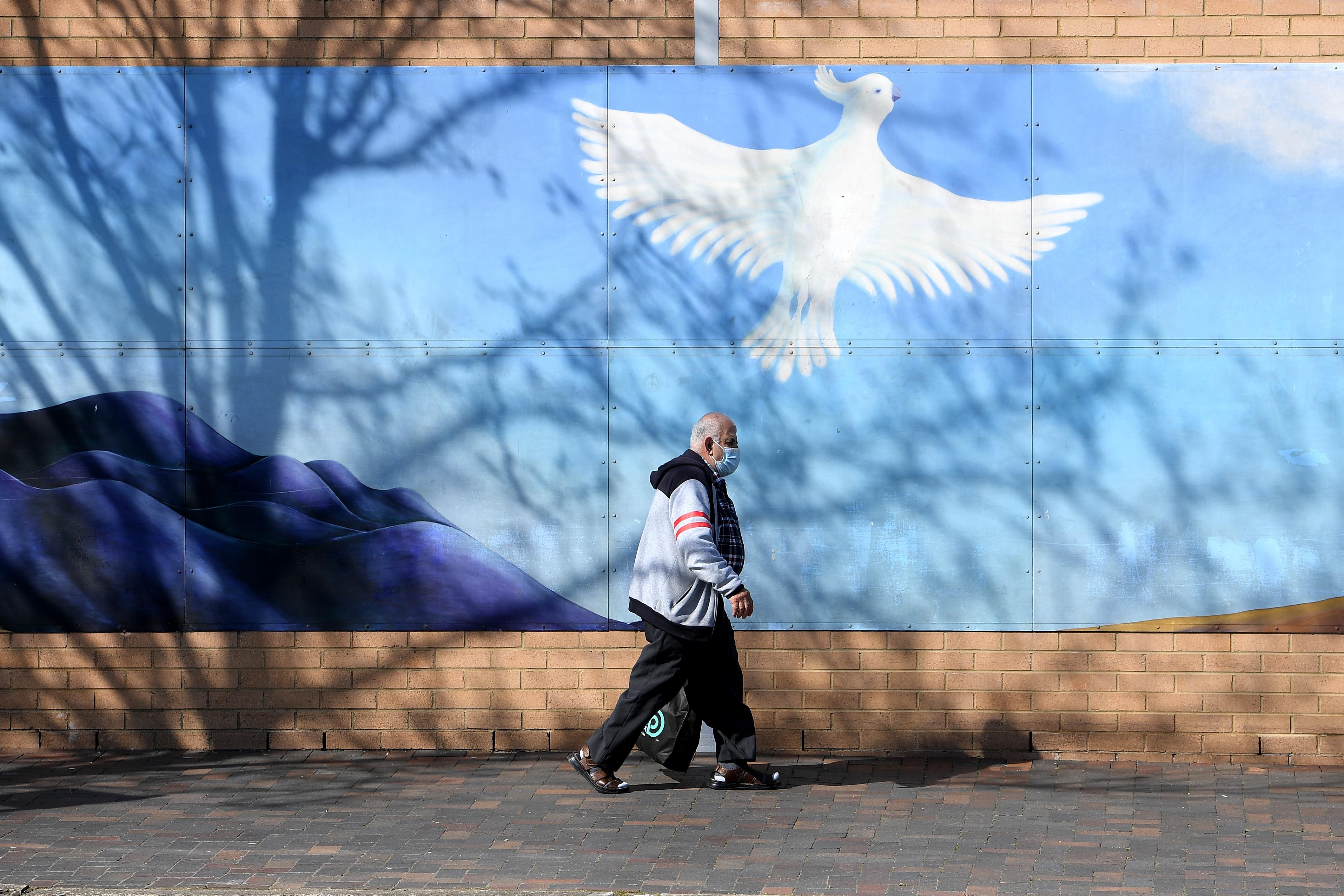 A person is seen in Fairfield in southwestern Sydney