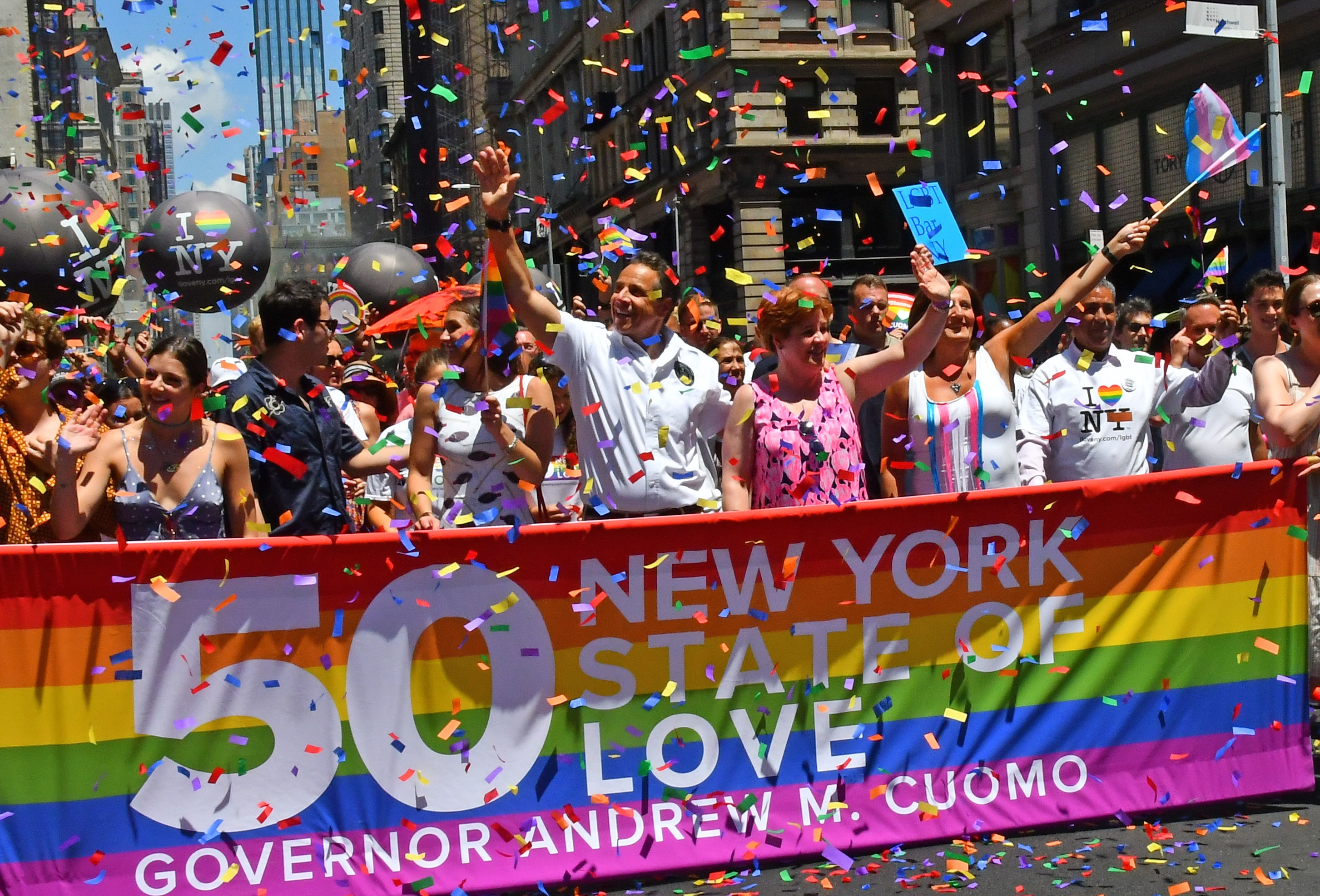 New York Governor Andrew Cuomo marches down Fifth Avenue in Manhattan at the World Pride Day parade marking the 50th anniversary of the Stonewall uprising.