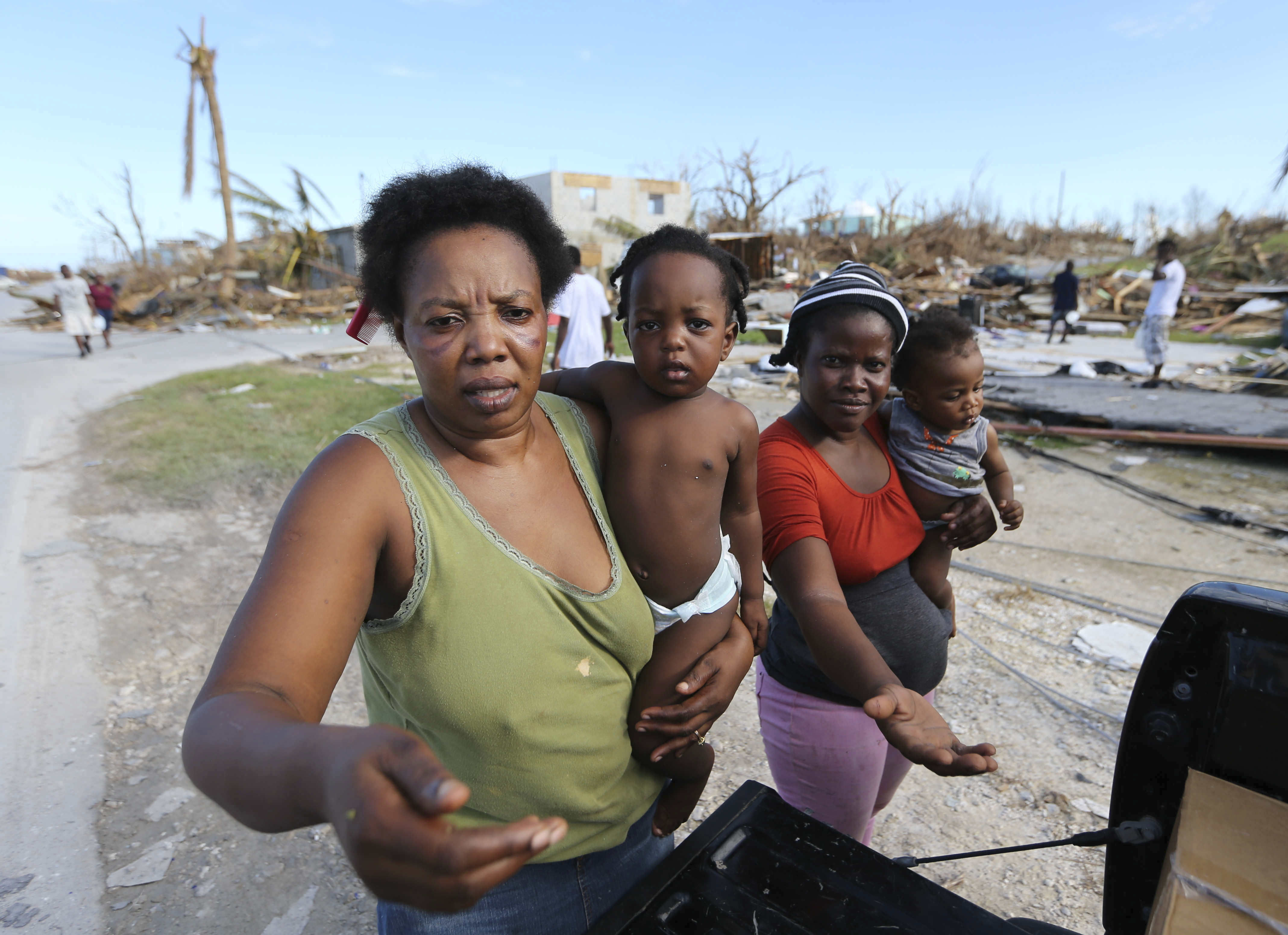 Residents an area destroyed by Hurricane Dorian ask for food and water from rescue volunteers in Marsh Harbor, Abaco Island, Bahamas.