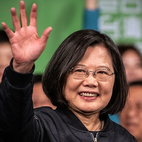 Tsai Ing-Wen waves to supporters following her re-election as President of Taiwan.