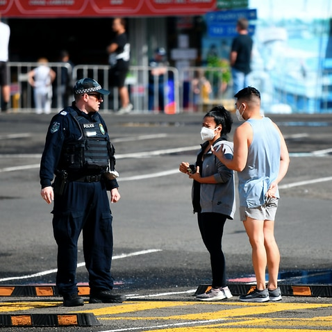 NSW police are seen on patrol as social distancing measures are put in place for Easter Long Weekend trading at the Sydney Fish Market
