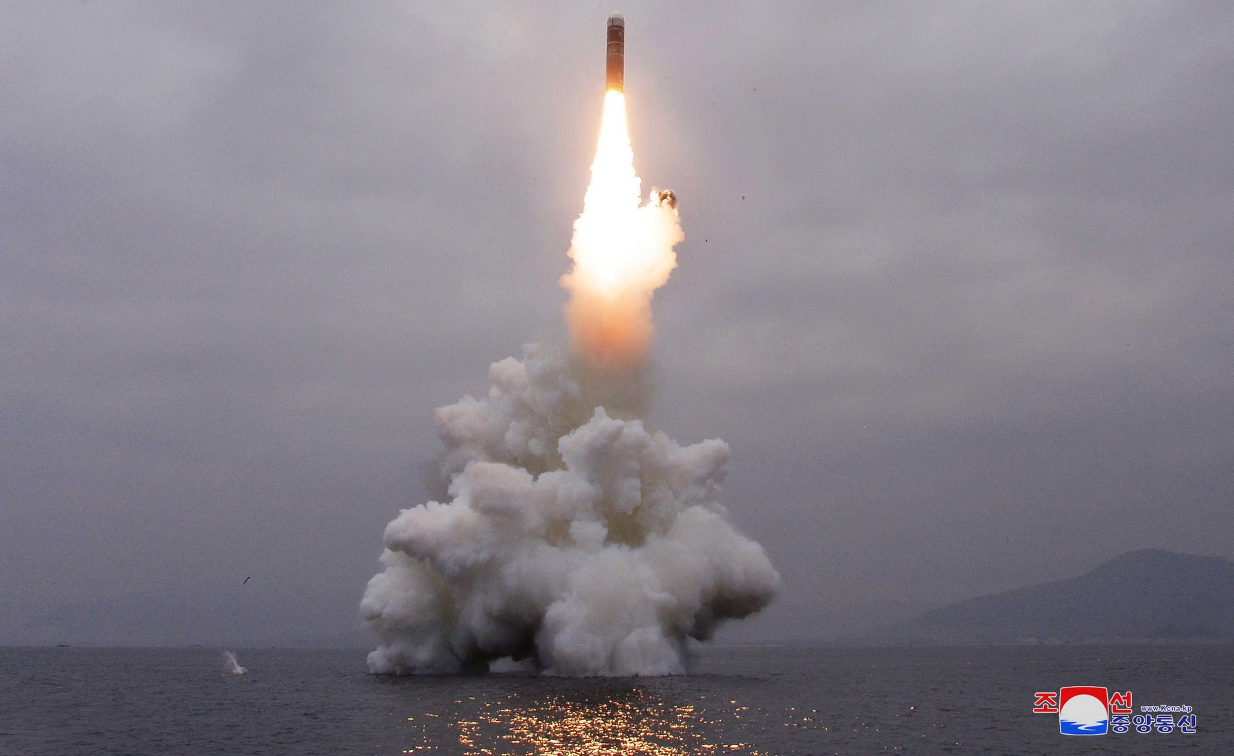 A photo released by the official North Korean Central News Agency (KCNA) shows the successful launch from a submarine of a Pukguksong-3, a new-type ballistic missile by the Academy of Defence Science of the Democratic People's Republic of Korea, in the wa