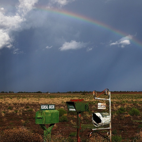 A rainbow appears behind a storm front on the Breeza Plains in north west NSW.