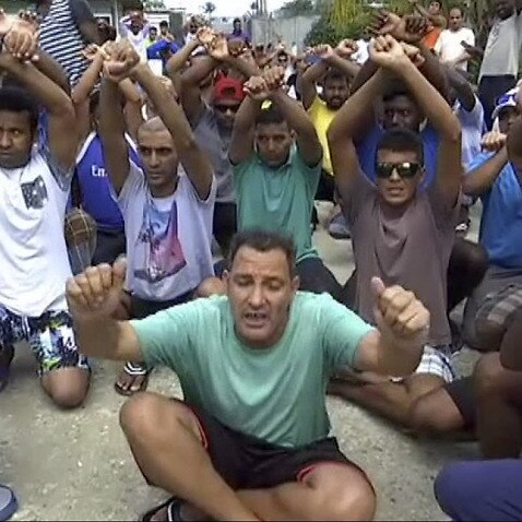 n this file photo made from Australia Broadcasting Coporation video made on Tuesday, Oct. 31, 2017, asylum seekers protesting the possible closure of their detention center, on Manus Island, Papua New Guinea.