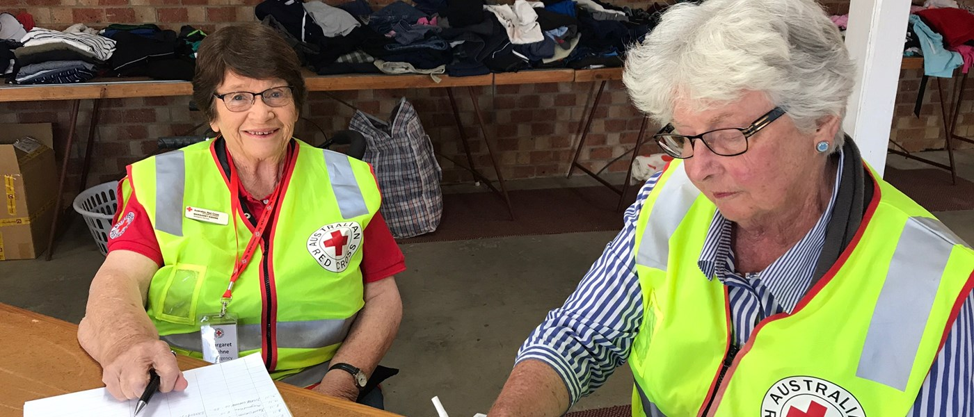More than 60 Red Cross volunteers including Margaret Kiehne and Jenny Sloman are offering assistance at 16 evacuation centres across New South Wales.