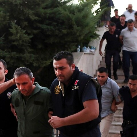 Members of Turkey armed forces are escorted by police for their suspected involvement in the attempted coup