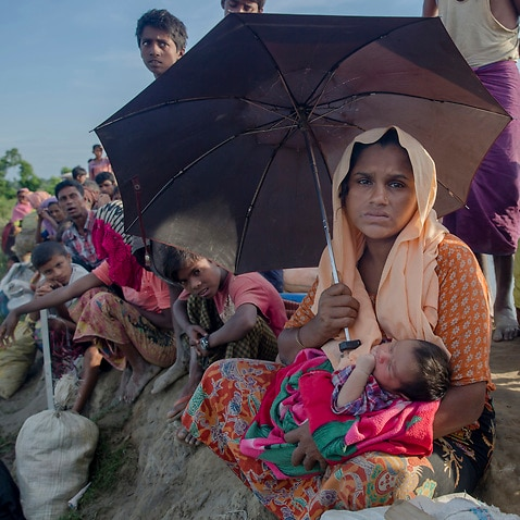 Rohingya Muslim woman Anjuna Khatoon, holds her 5-day-old baby girl who she gave birth to while making the journey across the border from Myanmar to Bangladesh.