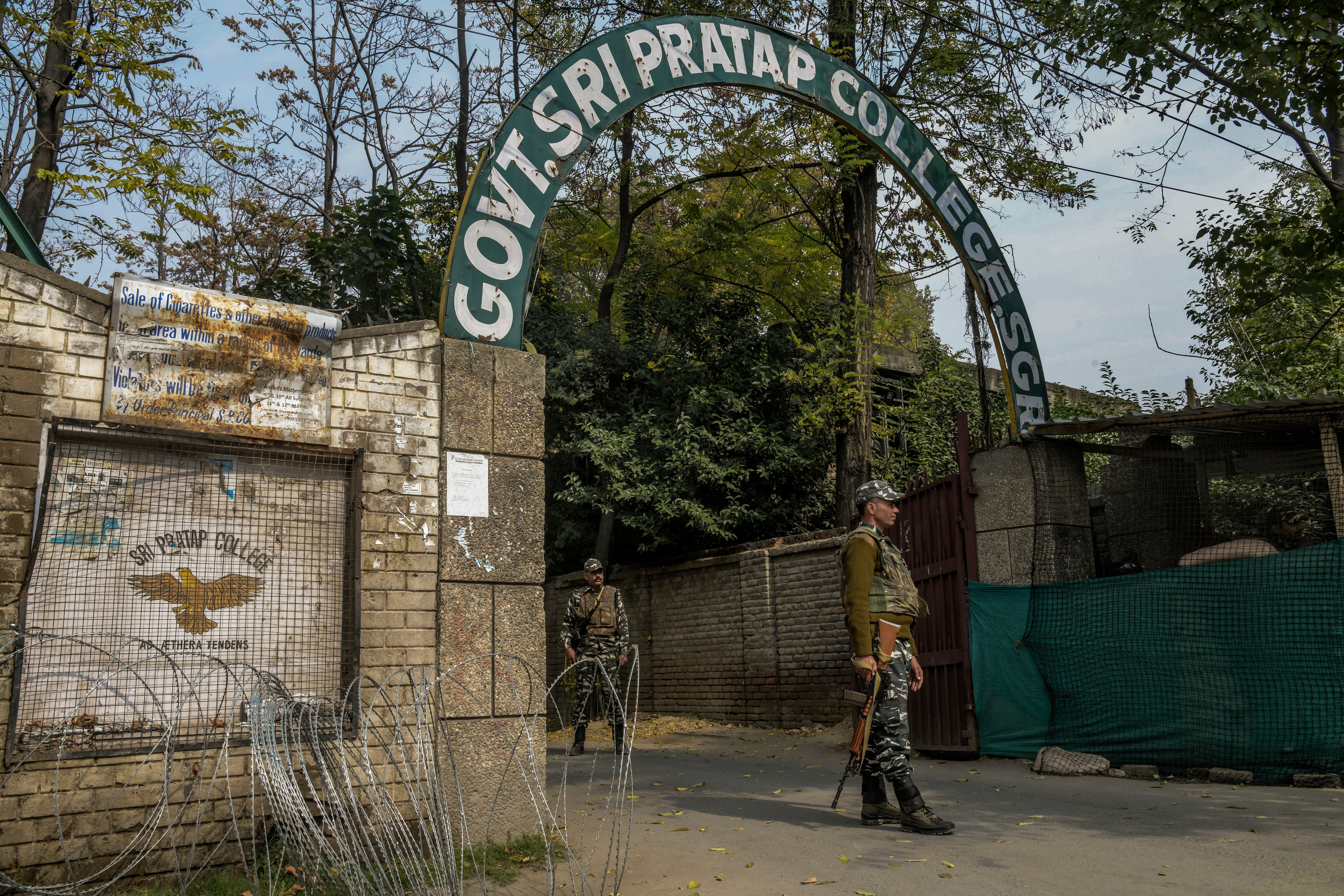 Security forces outside Sri Pratap College in Srinagar, India.
