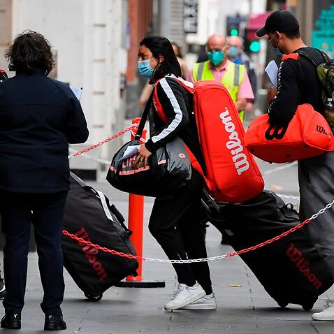 Tennis players, coaches and officials arrive at a hotel in Melbourne on 15 January, 2021.