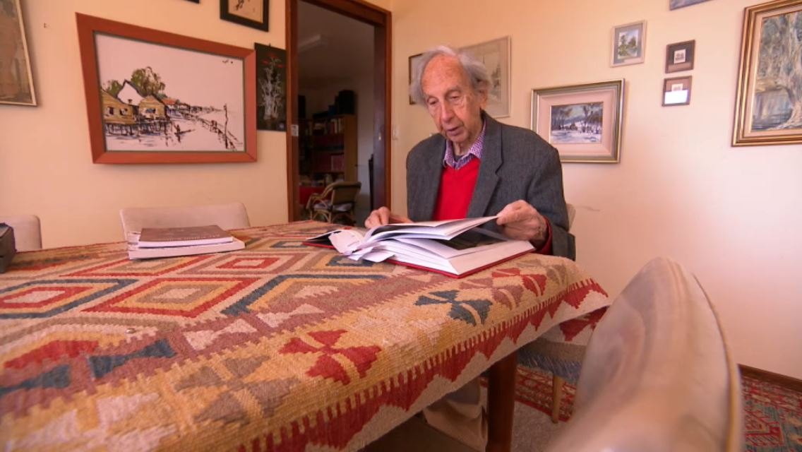 Bern reading through history books at his home in Canberra.