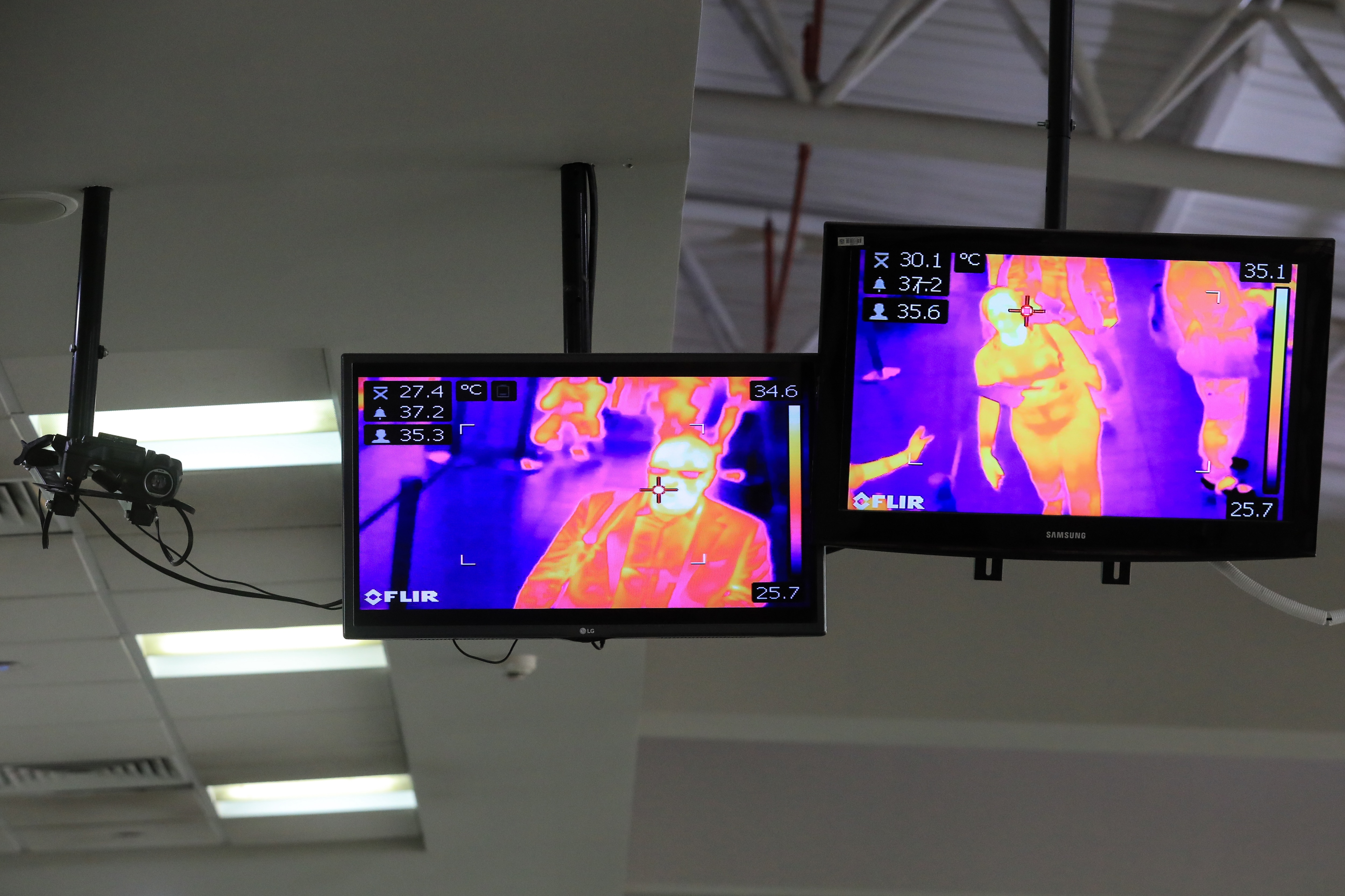 Travellers are being screened for temperatures using thermo cameras.