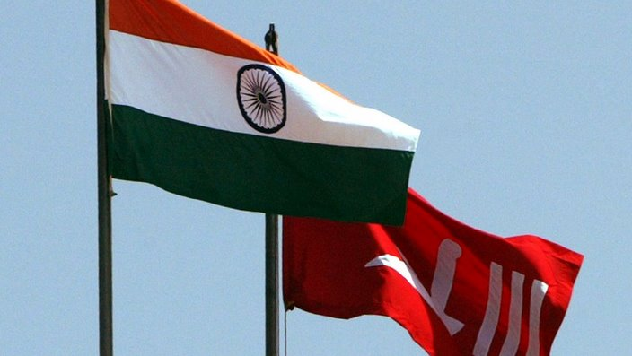 Indian national flag and the former flag of Indian-Administered Kashmir.