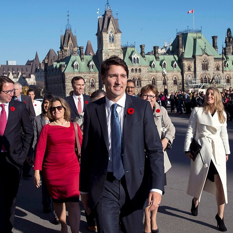 Prime Minister Justin Trudeau and his newly sworn-in cabinet ministers arrive on Parliament Hill in Ottawa on Wednesday, Nov. 4, 2015.  (Justin Tang/The Canadian Press via AP)