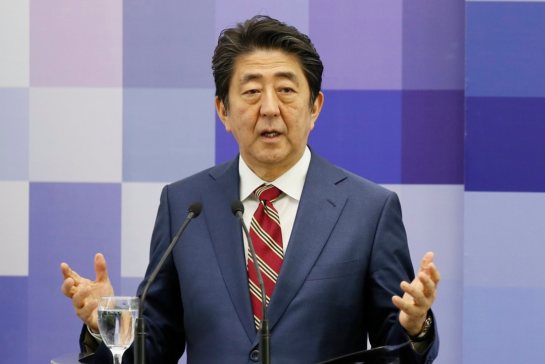 Japanese Prime Minister Shinzo Abe is treading a fine of appeasing business and conservatives.
