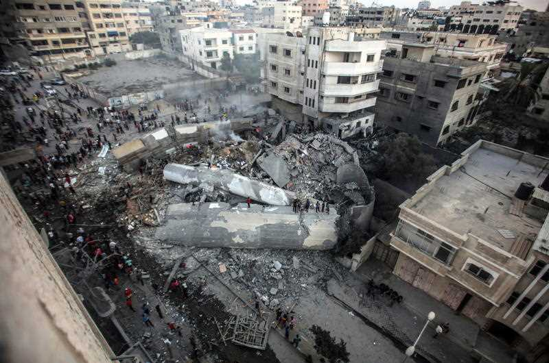 The Said al-Mishal Cultural Center building destroyed in this week's Israeli air strikes in the west of Gaza City.
