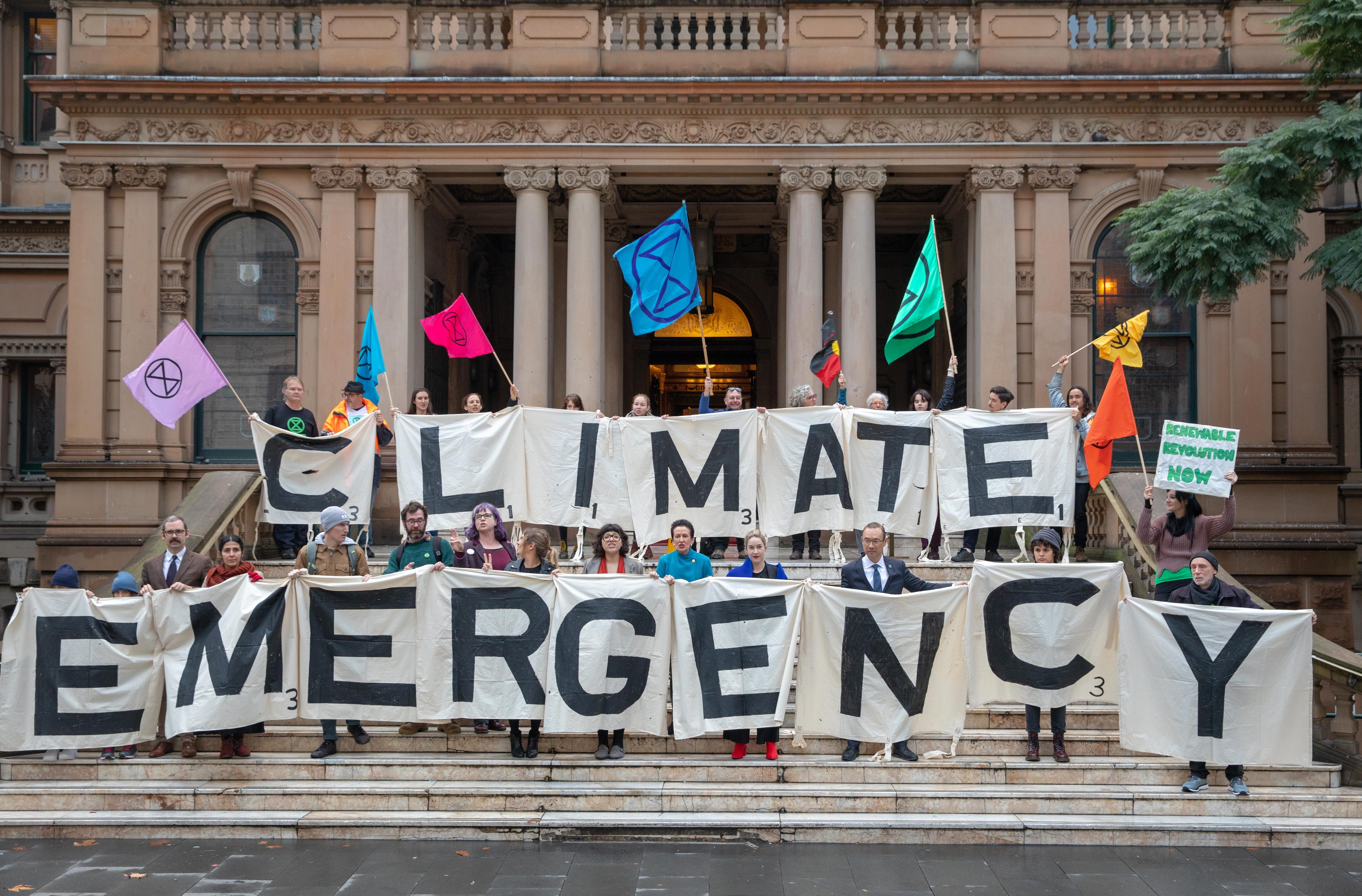 Activists from the Extinction Rebellion, Lord Mayor Clover Moore, Councillor Jess Miller, Councillor Jess Scully and Councillor Robert Kok at Sydney Town Hall.