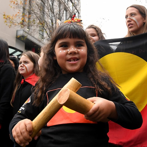 People participate in a NAIDOC Week march in Melbourne, 5 July 2019.