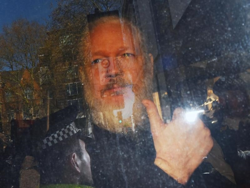 Julian Assange caught on camera skateboarding around Ecuadorian embassy
