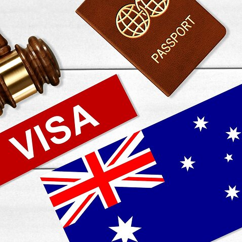 Visa to Australia concept with VISA Text near passport cover and Australian flag, hammer on white wooden background top view with copy space