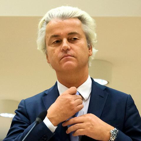 Populist anti-Islam lawmaker Geert Wilders prepares to address judges at the high-security court near Schiphol Airport, Amsterdam, Wednesday, Nov. 23, 2016.