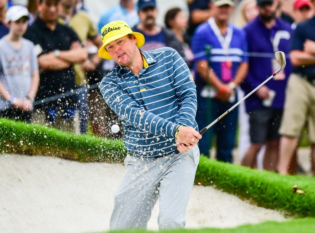 File: Jarrod Lyle hits from the bunker on #9 during third round action of the Crowne Plaza Invitational in 2015