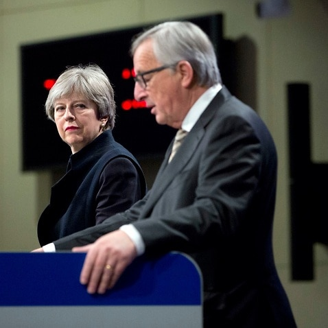 European Commission President Jean-Claude Juncker, right, and British Prime Minister Theresa May address a media conference at EU headquarters