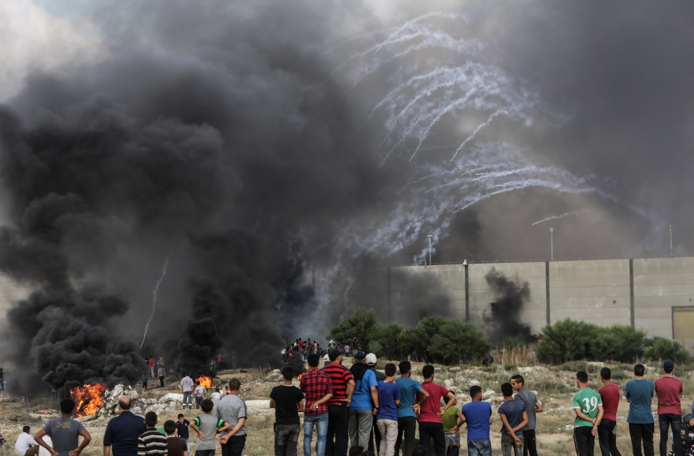 Palestinians protesters take part during the clashes with Israeli troops near the border with Israel in the east of Gaza City on, 20 July 2018.