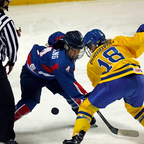 Unhyang Kim of Team Korea faces off against her Swedish opponenant in a friendly match ahead of the Winter Olympics.