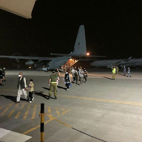 A Royal Australian Air Force C-130J Hercules arrives at Australia's main base in the Middle East region after returning from Kabul, Afghanistan.