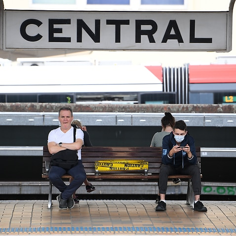 Commuters at an unprecedentedly quiet Central Station in Sydney.