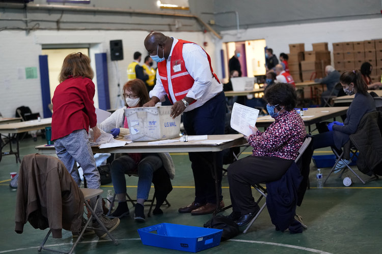 Election officials in Wisconsin and Georgia, said recounts in those states were very unlikely to reverse Donald Trump's losses.