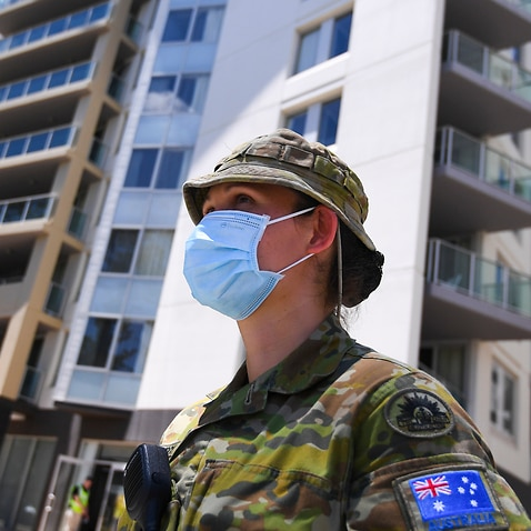 A member of the Australian Defence Force (ADF) stands guard at the Pacific Hotel in Canberra as Australians arrive to quarantine in November 2020.