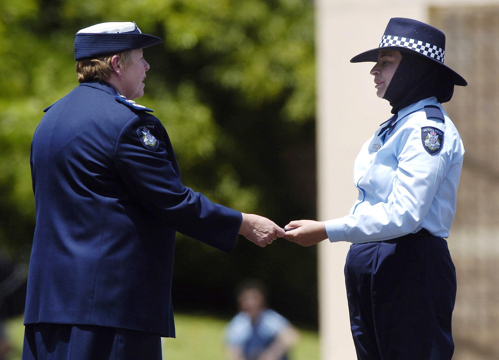 2004 - Police recruit Maha Sukkar receives her badge from Police Commissioner Christine Nixon